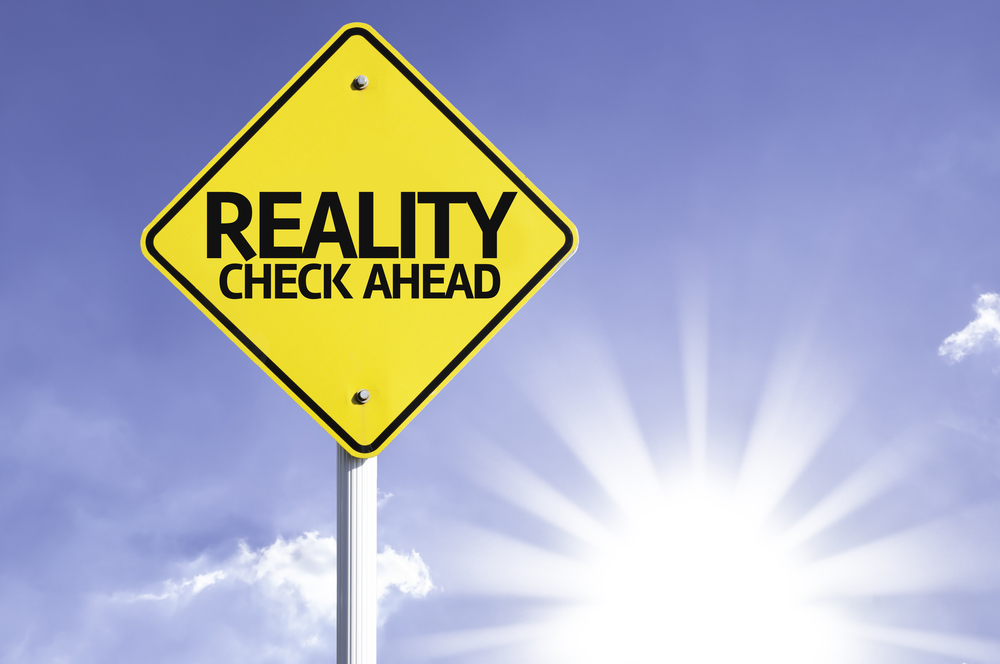 Reality Check Ahead road sign with sun background